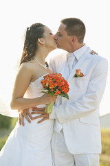 bride and groom kissing with isolated background