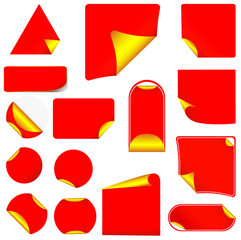 Red pealing paper with yellow corners, isolated on white
