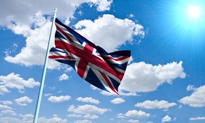 British Flag in front of vivid, sunny, cloudy sky