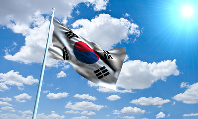 Korean Flag in front of vivid, sunny, cloudy sky