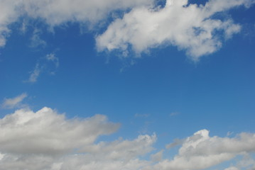 Whispy clouds in blue sky