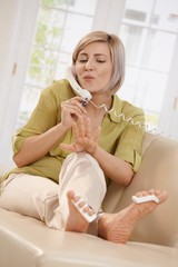 Woman polishing nails