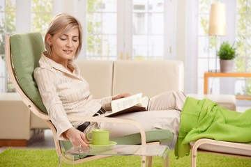 Woman with coffee mug at home