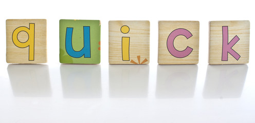 wooden tiles - spelling QUICK
