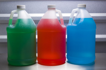 Gallon containers with colored liquid