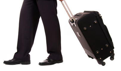 A businessman with suitcase at the airport