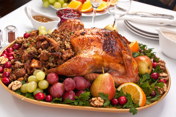 roasted holiday turkey garnished with fruit and salad