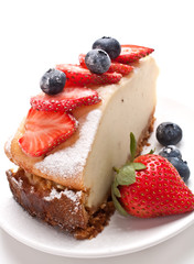 piece of tasty vanilla New York cheesecake with berries