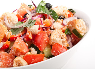 bowl of Panzanella bread salad on a white background