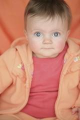 Baby In Orange Jacket