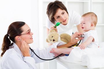 paediatrician checking baby