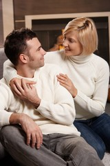 Couple hugging at home