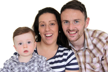 Happy father, mother and toddler looking at camera