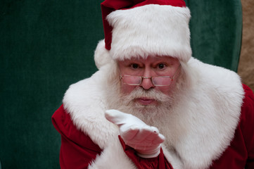 Santa blowing kiss