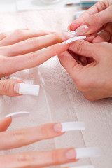 close-up of woman getting french manicure