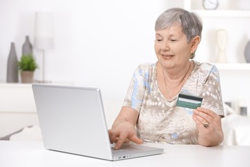 Senior woman shopping on internet