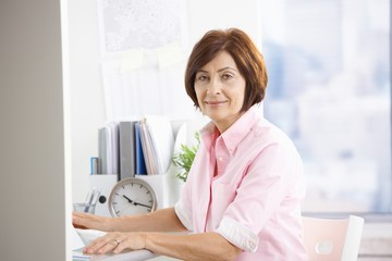 Mature office worker sitting at desk