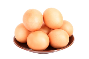 Group of brown hen's eggs in the plate isolated on white