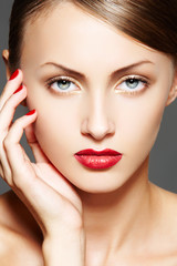 Luxury woman with make-up, juicy red lips, manicure, hairstyle