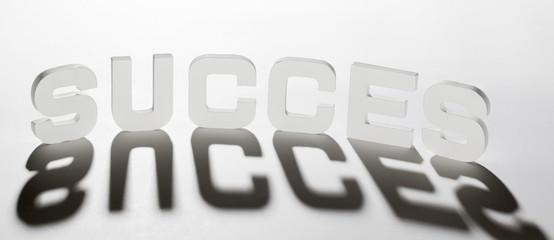 concept mot succès succes ombre et lumière