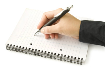 Pen in hand writing on the white page