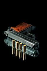 gun with bullet on a black bg