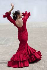 Traditional Woman Spanish Flamenco Dancer In Red Dress