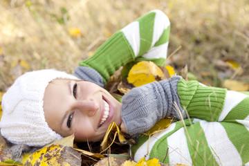 a portrait of a autumn woman smiling