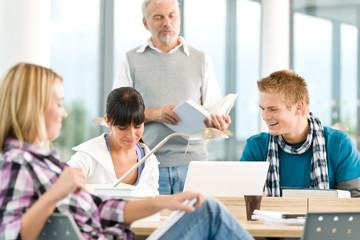 High school - three students with mature professor