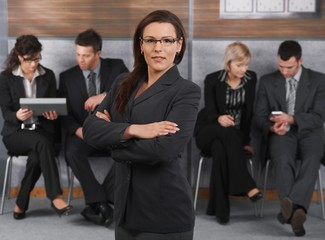 Businesswoman in front of team