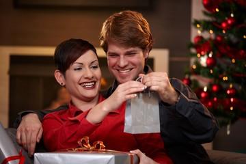Happy couple holding christmas presents