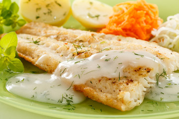 Printed kitchen splashbacks Ready meals Fish dish - fried fish fillet with vegetables