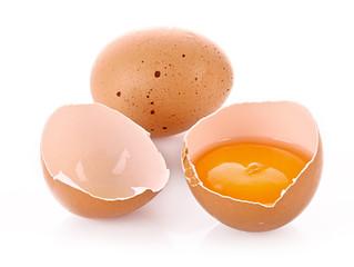 Broken egg isolated on white
