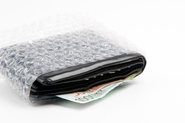 Wallet protected by plastic bubble film, save money concept