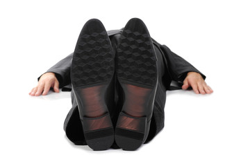 Businessman lying on the floor