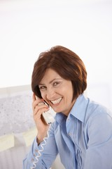 Portrait of senior office worker on phone