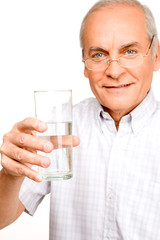 Pensioner with a glass of water