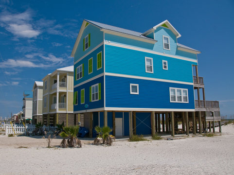 coastal blue beach house on stilts