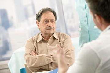 Senior patient listening to doctor