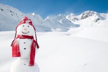 Happy snowman in mountain