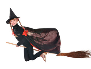 Child in costume Halloween witch  fly on  broom.