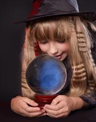 Girl holding crystal ball.