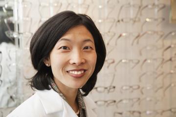 Korean optician standing in store