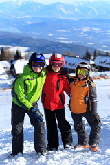Kids on mountain slope in snow