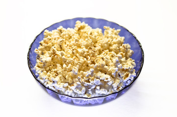 Popcorn in a blue basket. Isolated on a white background