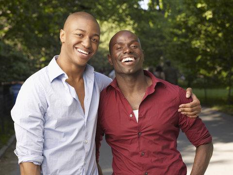 African men hugging and smiling