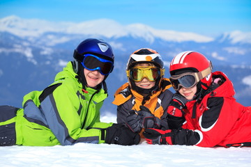 Kids in snow on mountaintop