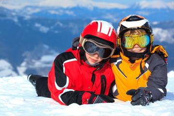 Children on snowy mountain
