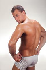 Portrait of young bodybuilder man.