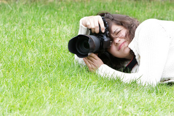 girl taking pictures on natural background